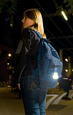 girl with reflector attached to rucksack